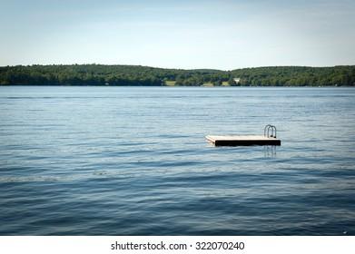 Swim platform floating on a lake.