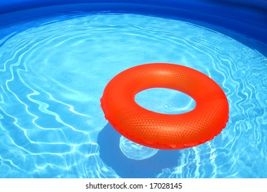 Swim ring inflatable floating on a sparkling blue swimming pool