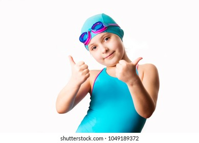 Swimmer: little 7 years old cute caucasian girl in cyan swimming costume . Isolated on white background.