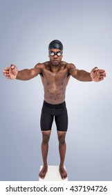 Swimmer ready to dive against grey vignette