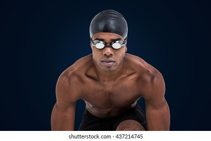 Swimmer ready to dive against purple vignette