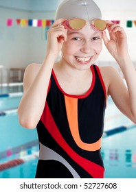 Swimmer schoolgirl in swimming pool portrait