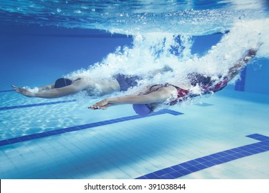 swimmer woman Jump from platform jumping a swimming pool.Underwater photo