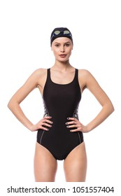 Swimmer women in swimming suit standing isolated on white background, looking to camera with confidence