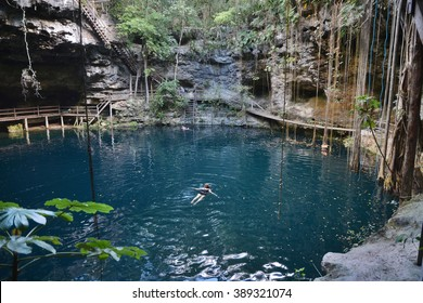 Swimmeres in X-Canche cenote in Yucatan peninsula, Mexico.