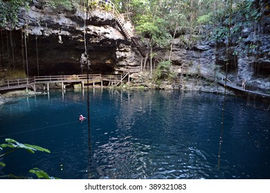 Swimmeres in X-Canche cenote in Yucatan peninsula, Mexico.This cenote is 30 km from center of town Valladolid near Mayan site Ek Balam. Yucatan peninsula, Mexico.