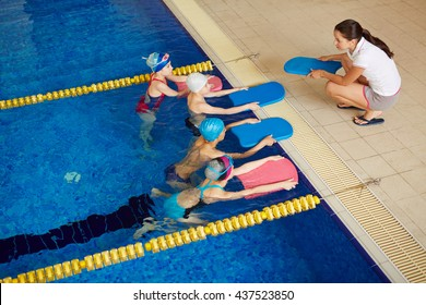 Swimmers with coach