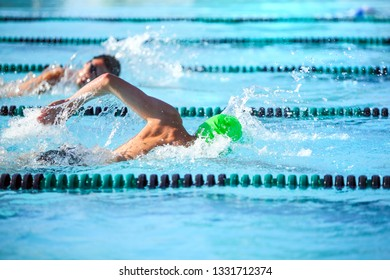 Swimmers in a freestyle race