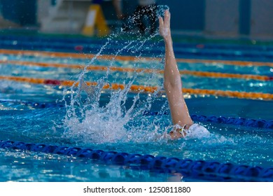 Swimmer's hand in the pool
