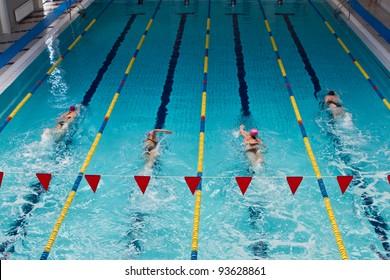 swimmers in indoor pool