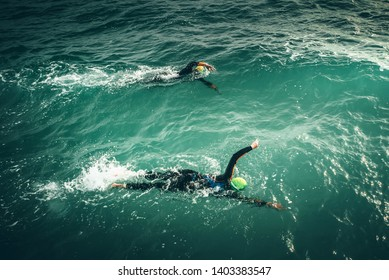 Swimmers swim during Swimming Competition in the Sea. Open water sport race