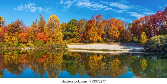 The swimming beach surrounded by Autumn leaves in Schooly's Mountain Park in Washington Township New Jersey.