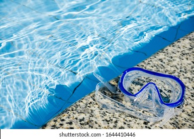 Swimming blue mask. Pool with clear blue water. Sunny day. The concept of a summer sea holiday. Place for an inscription.
