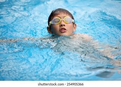 swimming boy in glasses
