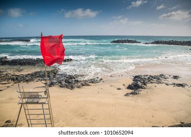 Swimming is dangerous. Red flag sign at beach side