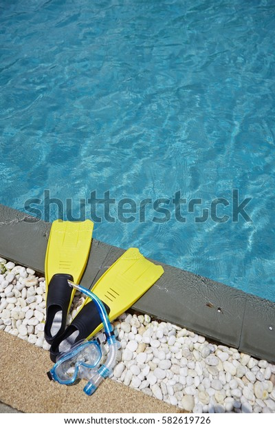 Swimming fins and snorkel mask