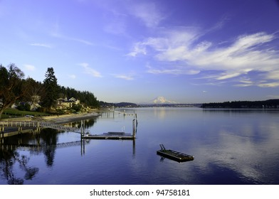 Swimming float on Hale Passage between Gig Harbor and Fox Island Washington with Mount Rainier in alpenglow in the background.