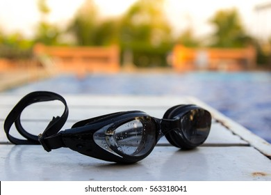 Swimming glasses on the table near the pool