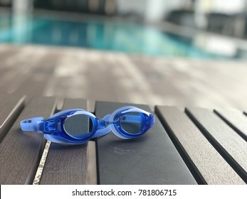 swimming goggles by the pool