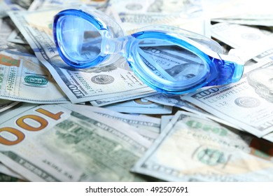 Swimming goggles  on money bills