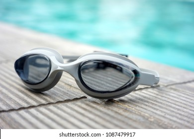 Swimming googles on the floor near the swimming pool