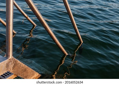 "swimming ladder at the ""alte donau"" old danube in vienna. evening light, sundown. - Shutterstock ID 2016052634"