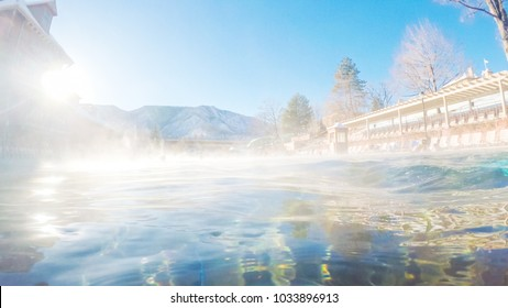 Swimming in outdoor hot springs pool in the Winter.