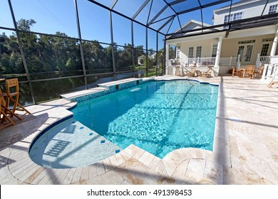 A swimming pool area at a large home