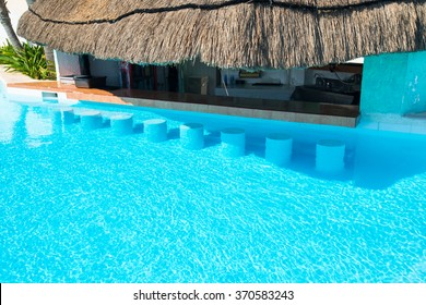 Swimming Pool Bar area with seats underwater at poolside. Vacation concept