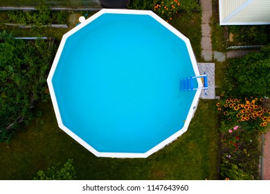 Swimming pool with blue clear water. Aerial photography.
