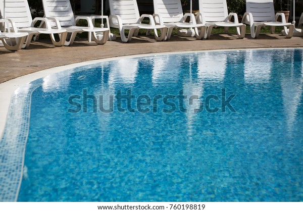 Outdoor Natural Gas Fire Pit Table, Swimming Pool Blue Crystal Water Lounge Stock Photo Edit Now 760198819