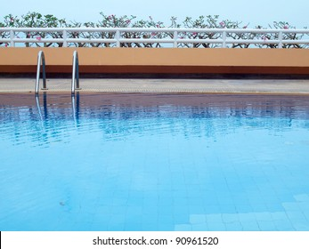 Swimming pool with blue water on terrace of condominium