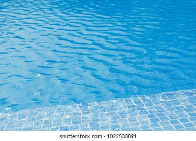 swimming pool with blue water and tile