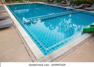 Swimming Pool. swimming pool bottom caustics ripple and flow with waves background. Swimming pool of luxury hotel.