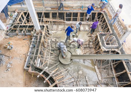 Swimming Pool Construction. Workers Were Pouring Concrete Work.construction  Work.