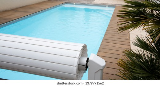 Swimming pool cover detail for protection and heating hot blue water