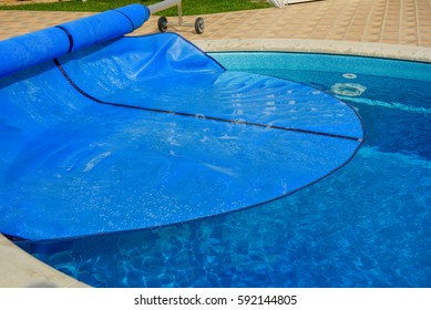 Swimming pool with cover from dirt and isolation.