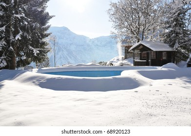 Swimming pool covered with snow