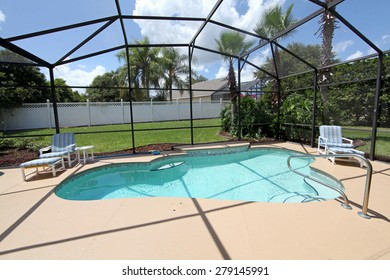 A swimming pool and deck with screen