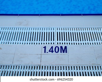 swimming pool depth marker and overflow grating