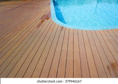 swimming pool with fake wood flooring stripes summer vacation
