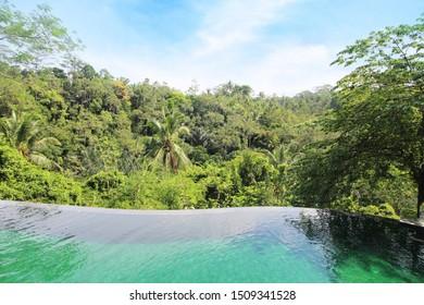 Swimming pool at the holiday, background is beautiful mountain. in the tropical jungle Resort, Komaneka At Tanggayuda, Ubud, Bali - March, 15, 2019