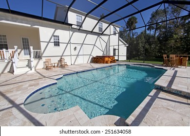 A swimming pool and hot tub at a large home