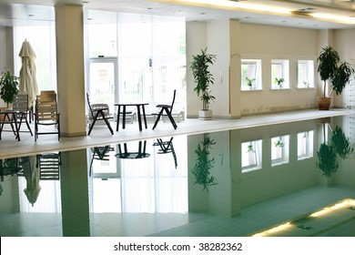 Swimming pool in a hotel in front of bright window