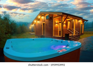Swimming pool with hydromassage next to house. Modern pool near to cottage. Bath with outdoor hydromassage. Bath for SPA procedures. Country cottage in evening. Concept - rest outside city