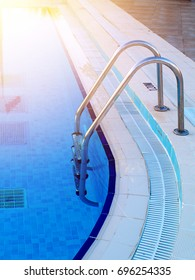 swimming pool in-pool ladder and overflow gratings, sunlight effect toned