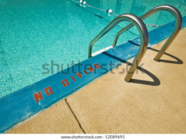 Swimming pool ladder and warning