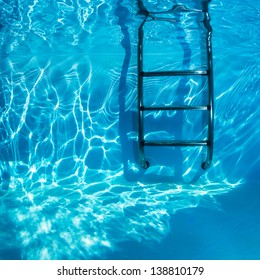 Swimming pool Ladders Underwater in a clear freshwater.
