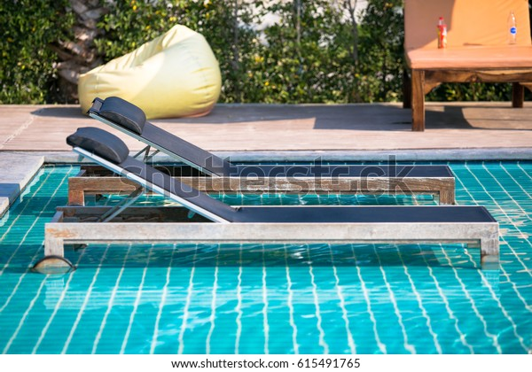Swimming Pool Lounge Chairs Umbrellas On Stock Photo (Edit ...