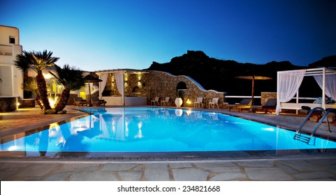 Swimming pool of luxury hotel at dusk